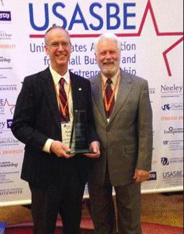 Frank Hoy celebrates his award with his mentor, John Pettit. Photo courtesy of USASBE.