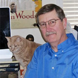 Wes Mott with his cat, Harry. alt