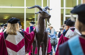 During the procession out of the tent, many of the graduates gave Gompei a farewell pat. alt