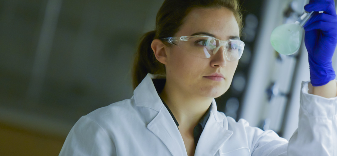 Person working in lab looking at experiment