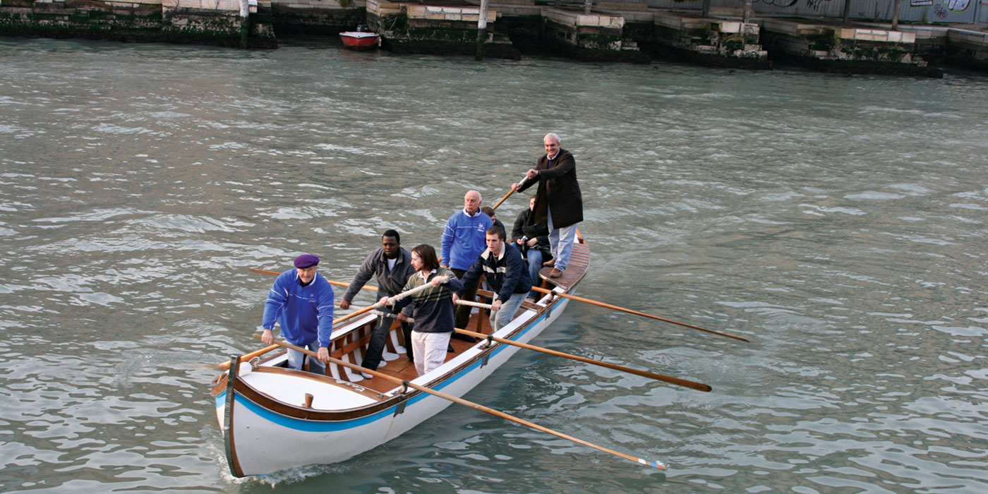 Students and faculty on a boat at the Venice, Italy project center