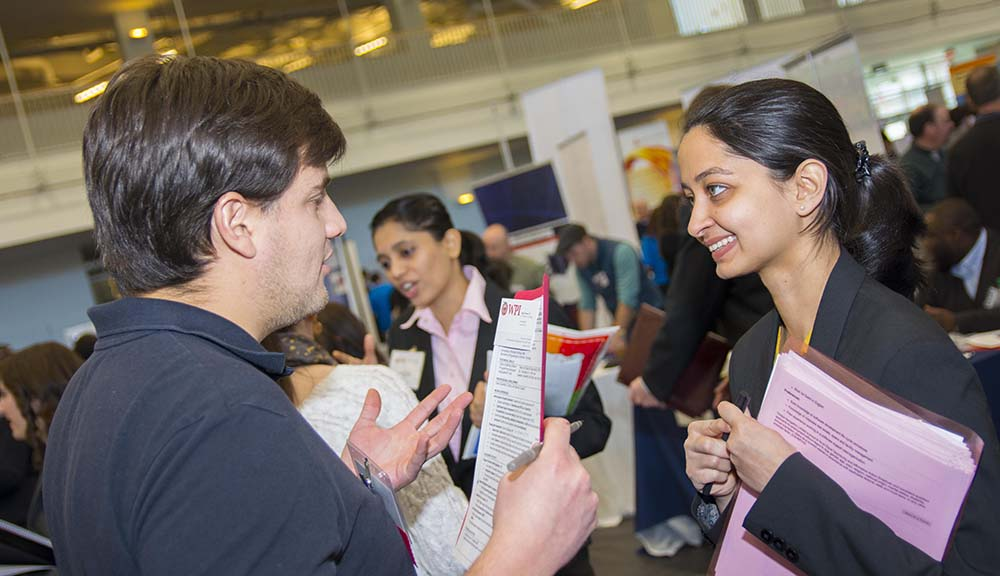 Recruiter interviewing a student during career fair