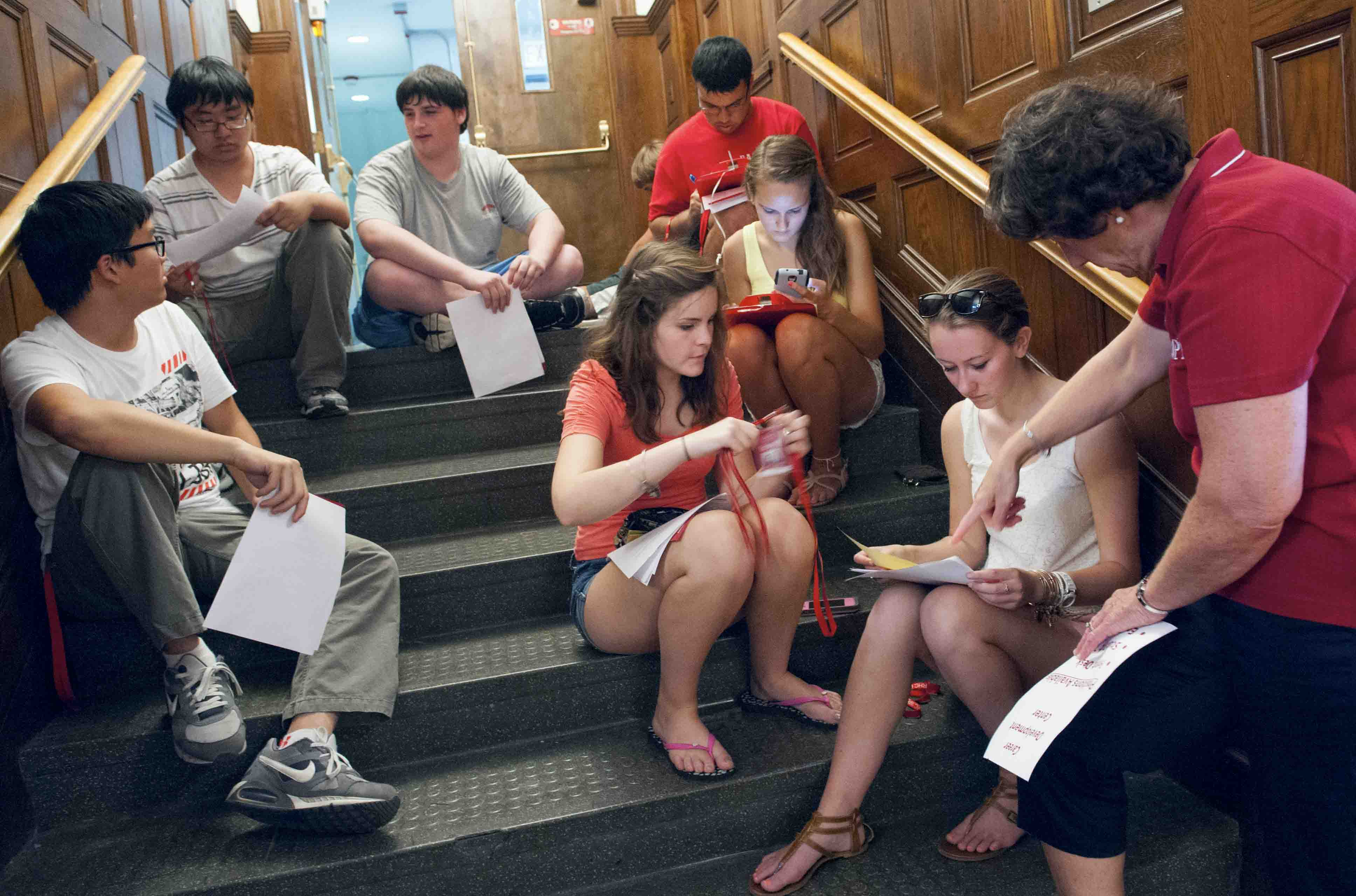 WPI students sitting on a staircase in Riley Commons.