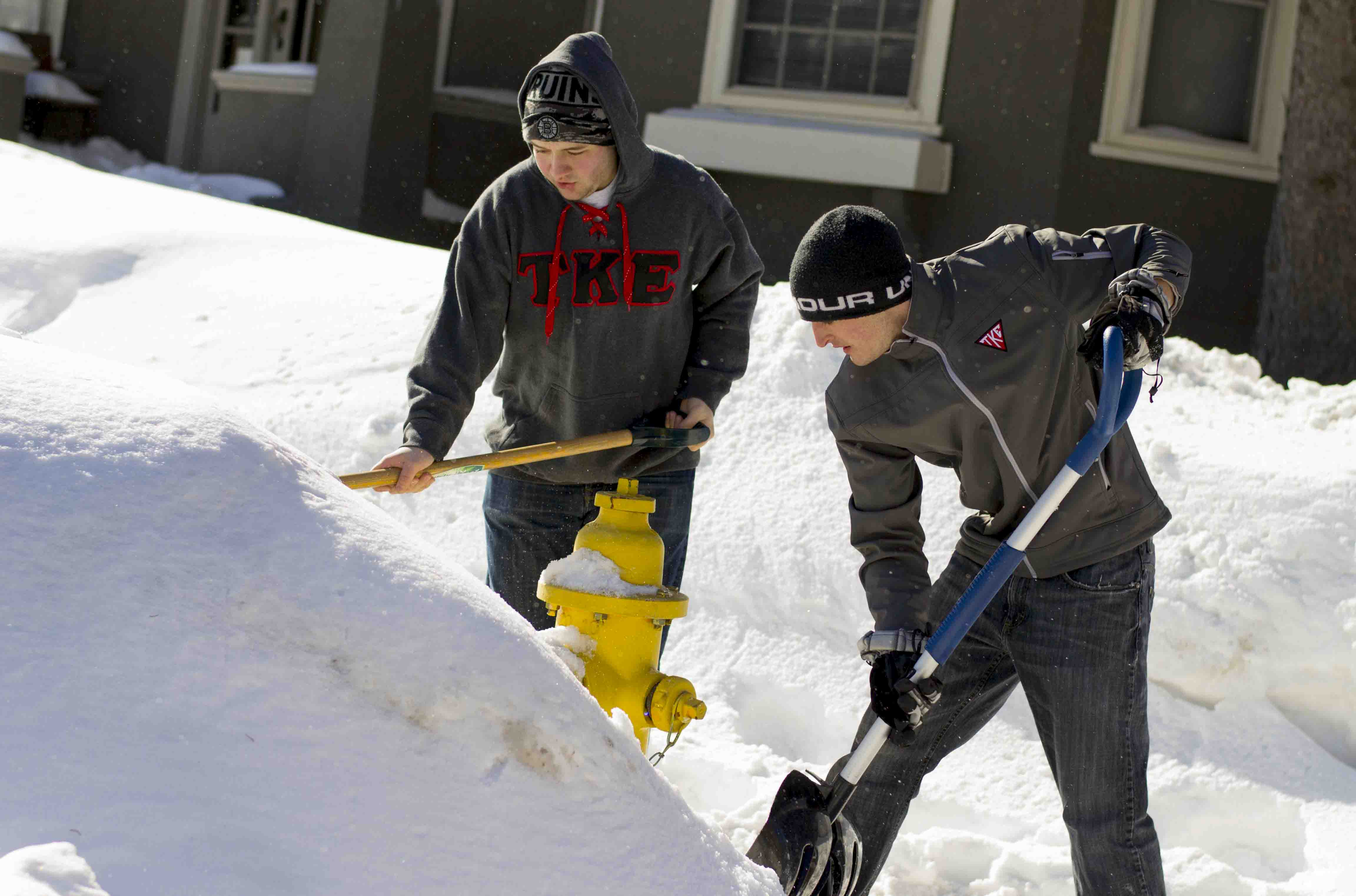 Students shoveling after snow storm