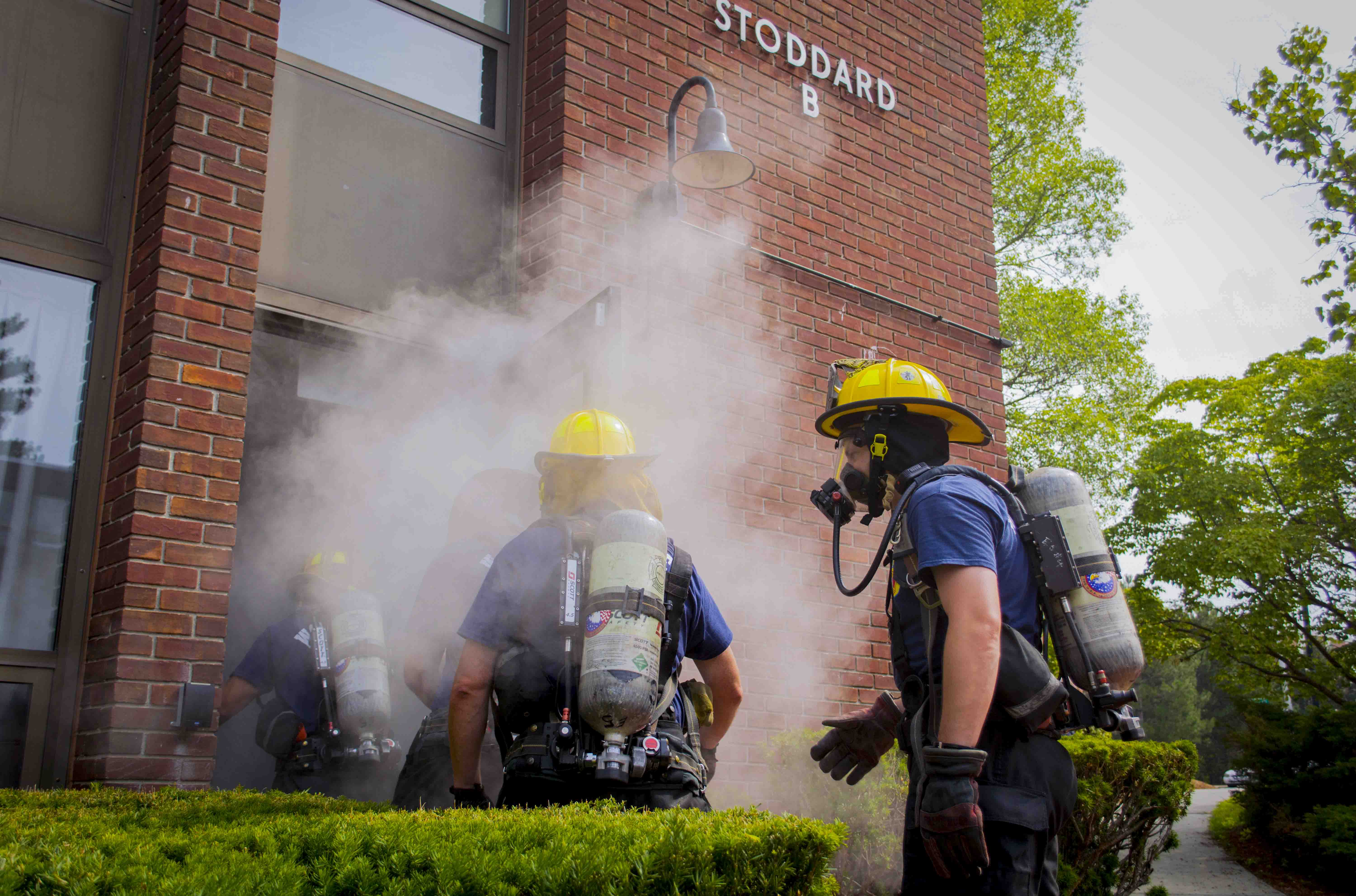 Firefighters entering smokey Stoddard Residence Hall