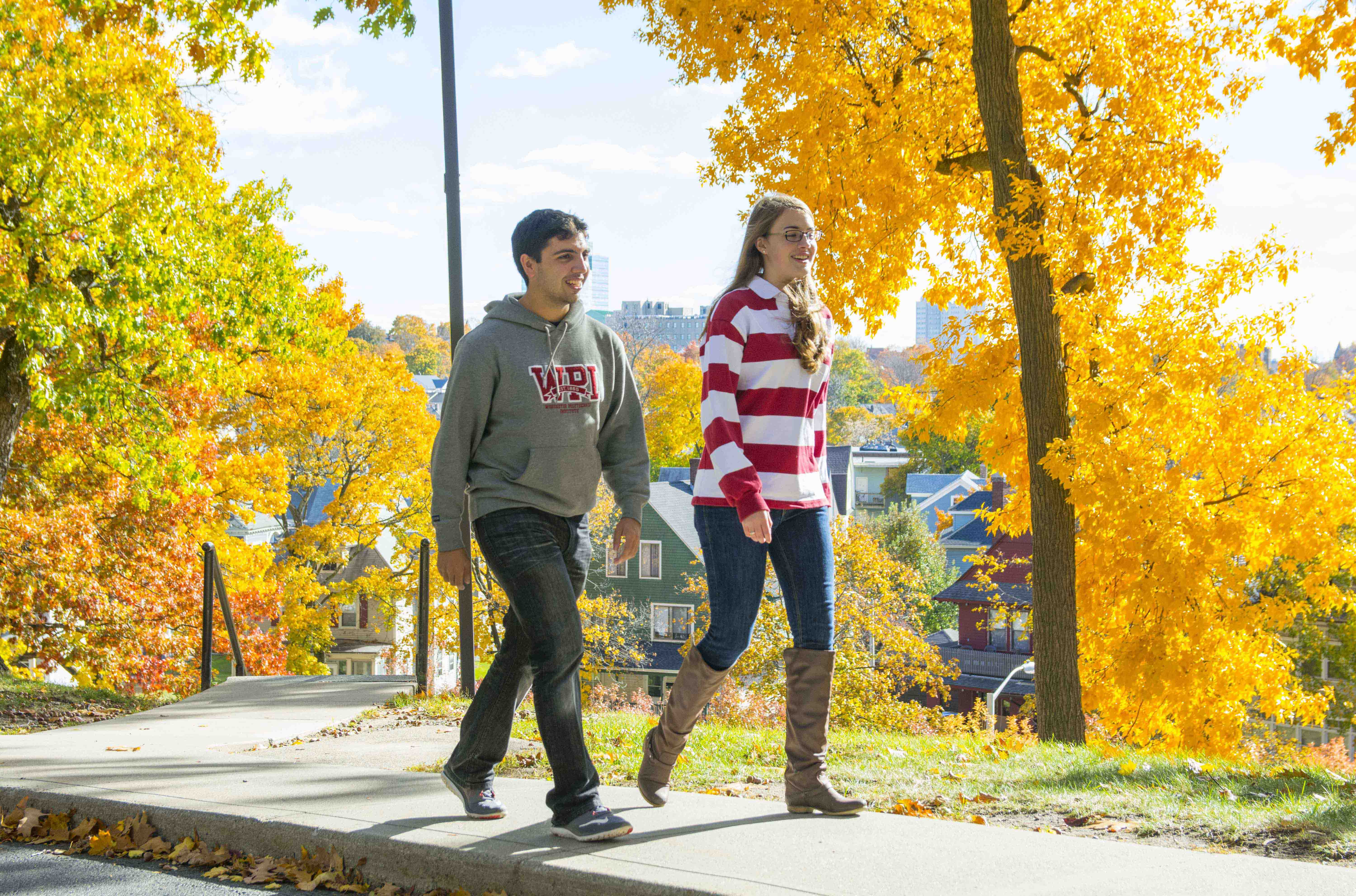 Students walking on campus in the fall foliage