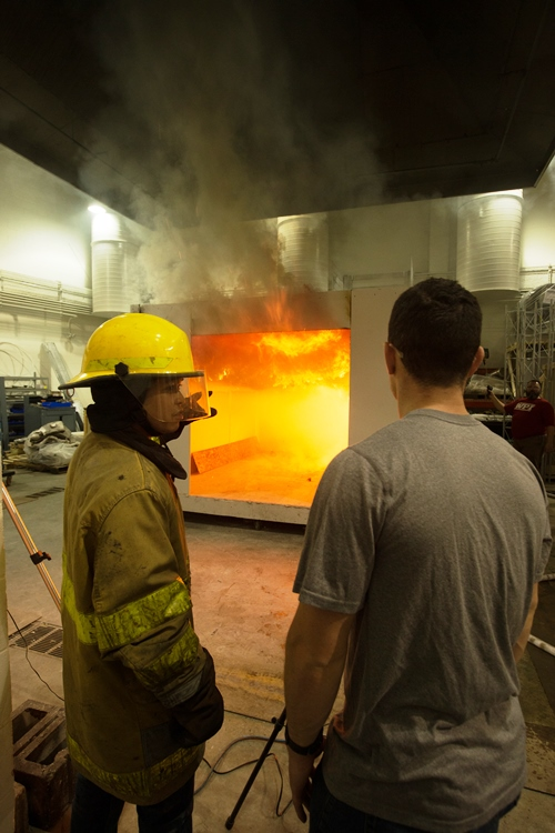 Students observe a fire test in the Performance Lab.