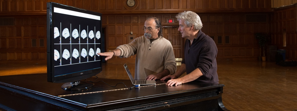 Richard Falco and Frederick Bianchi eaaming fMRI images