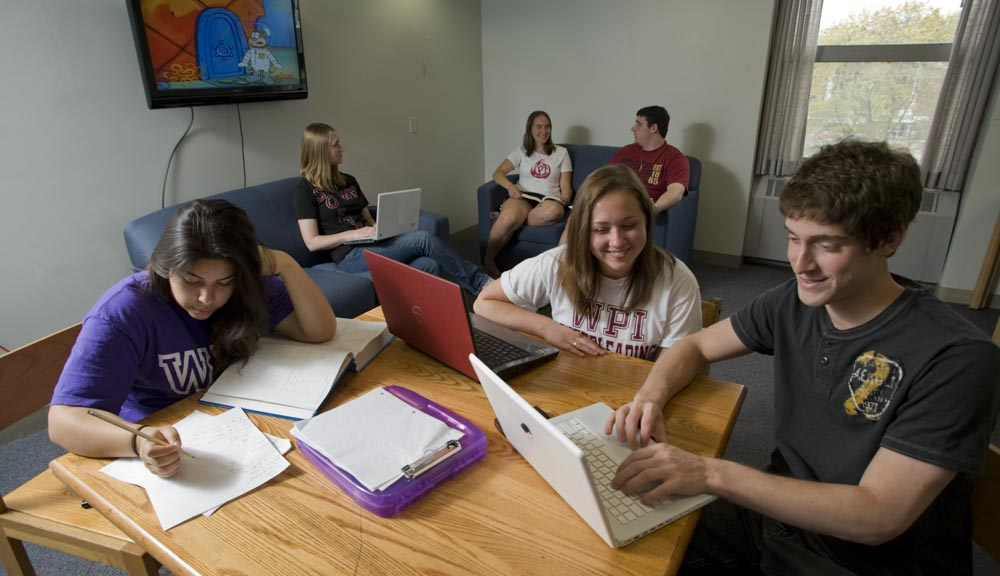 Group of students studying in the common area of the dorm