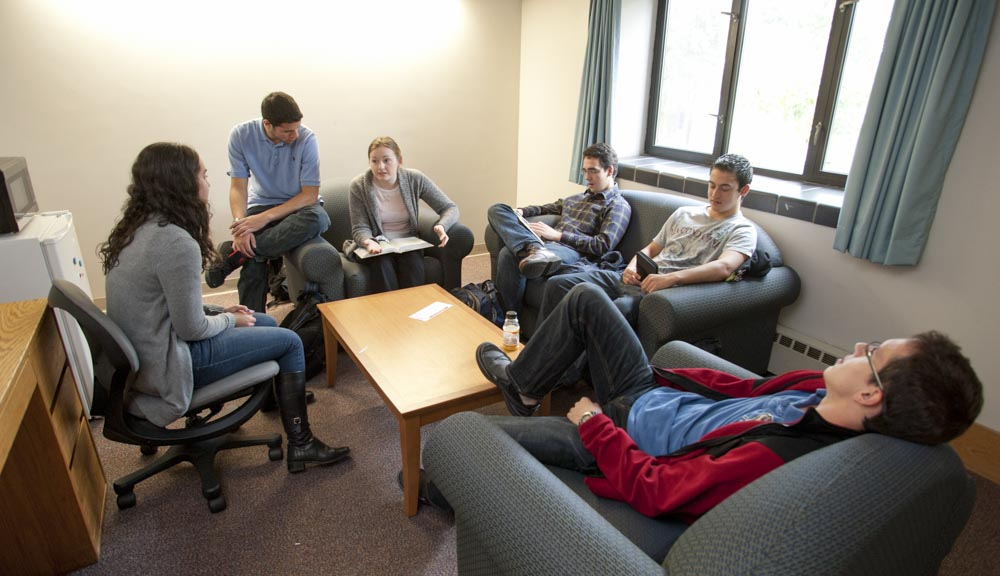 Students chatting in the living room in Founders Hall