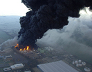 aerial shot of large warehouse on fire