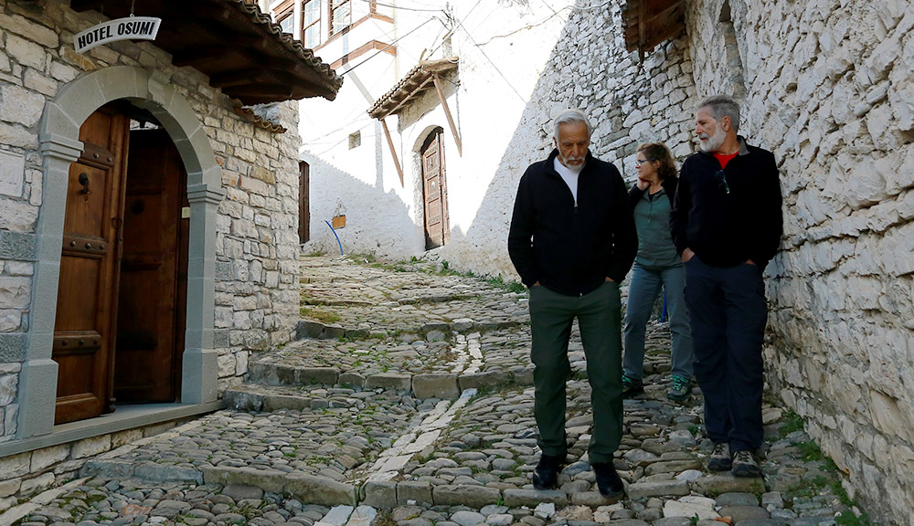Walking the stone streets in the heart of the historic core of Berat in southern Albania  alt