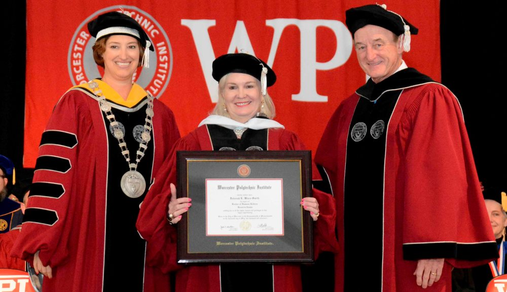 Deborah Wince-Smith, center, receives an honorary doctorate from WPI President Laurie Leshin, left, and WPI Board Chairman Jack Mollen