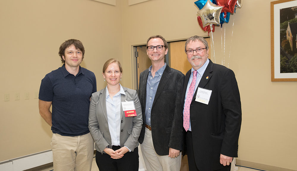 Mass Academy alumni Andy Ross, Maggie Frost Groll, and Tommy Boucher pose with Director Michael Barney.