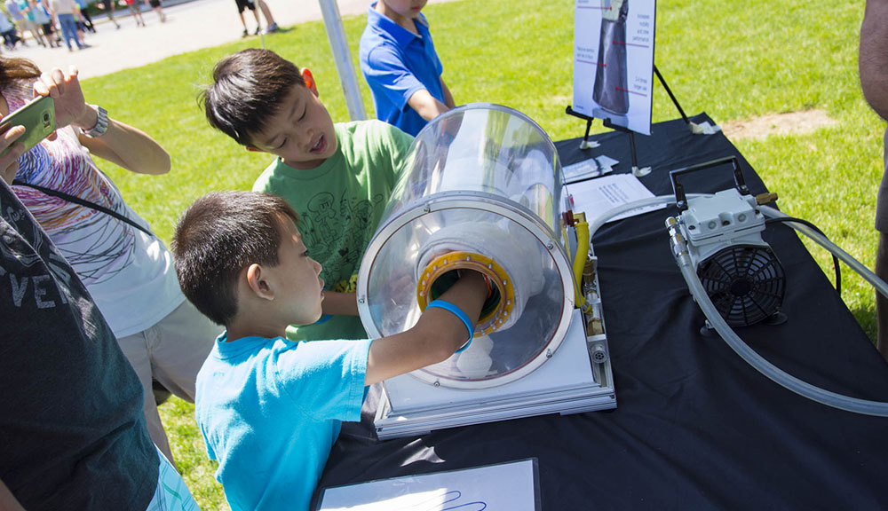 Two young boys test out an experiment at TouchTomorrow.