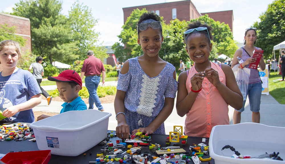 Two young girls play with LEGOs during TouchTomorrow.