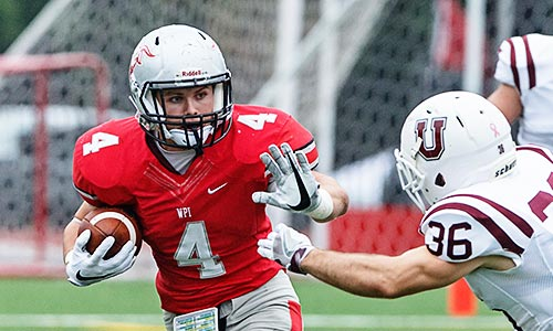 WPI Engineers football running back block opponent while running with the ball.