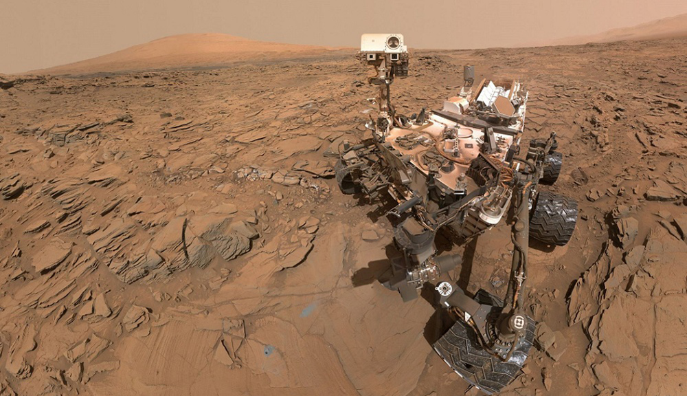 An illustration of the Curiosity rover on the surface of Mars.