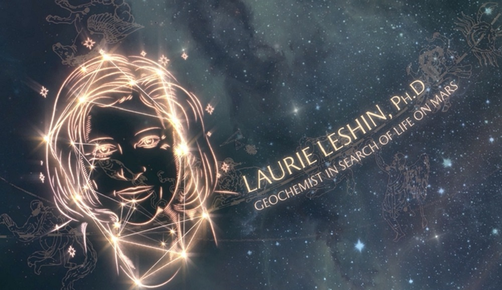 Laurie Leshin's image is projected on the ceiling of the Grand Central terminal in the form of a constellation. In gold text next to her is