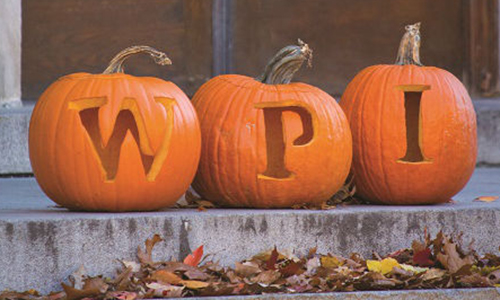 WPI Open House image of pumpkins with fall leaves