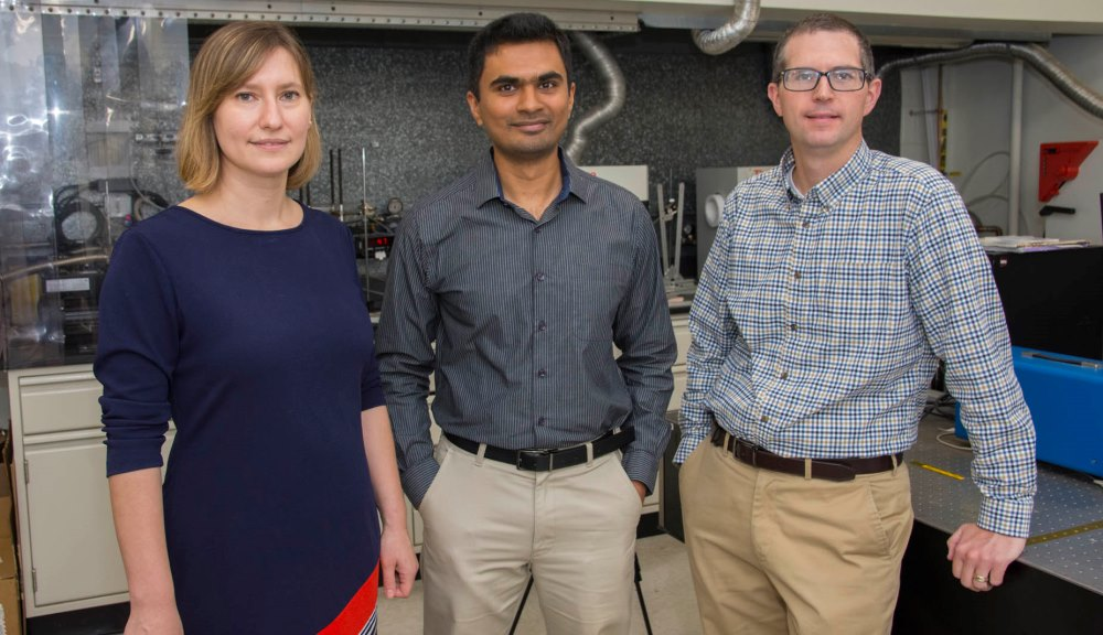 From left, From left, Lyubov Titova, Pratap Rao, and Aaron Deskins, stand in the WPI NanoEnergy Lab looking toward the viewer