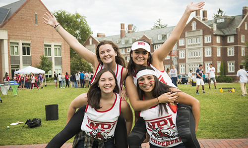 Four female WPI students celebrating their life at WPI