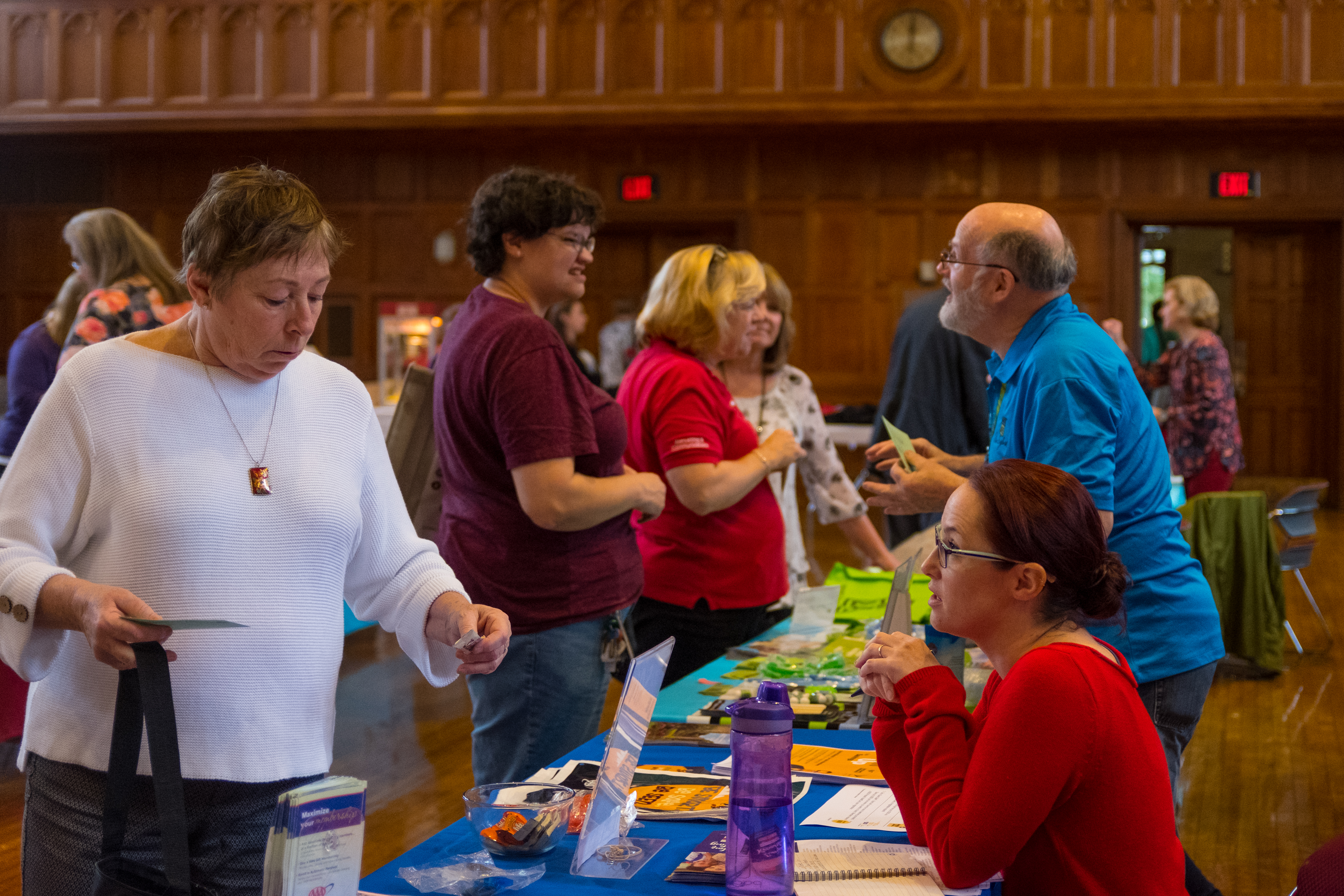 WPI employees talking across a table to vendors who offer WPI benefits