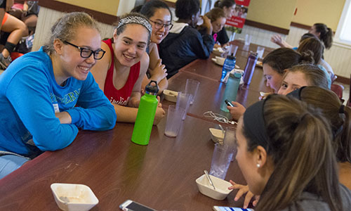 Frontiers students enjoying a lively conversation in Morgan Dining Hall on the WPI Campus.