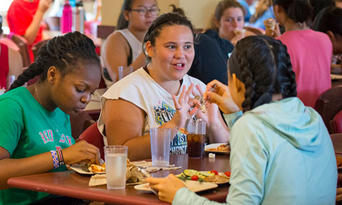 Frontiers students sharing a meal in Morgan Dining Hall on the WPI Campus.