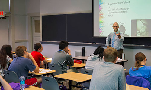 Students listening to a professor in the Humanities & Arts Frontier Camp.