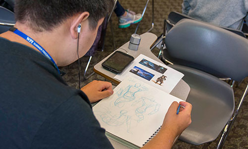 Student working on a project at the Humanities & Arts Frontier Camp.
