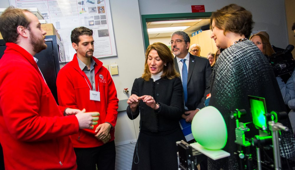 Lt. Gov. Karyn Polito, center, tours a photonics lab at WPI