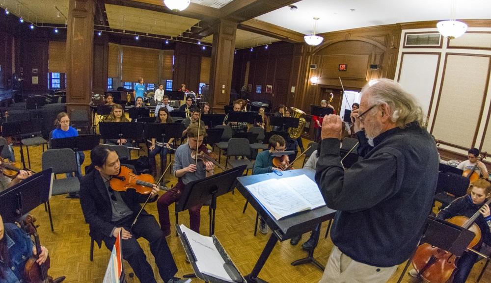 Douglas Weeks conducts rehearsal in Alden Memorial