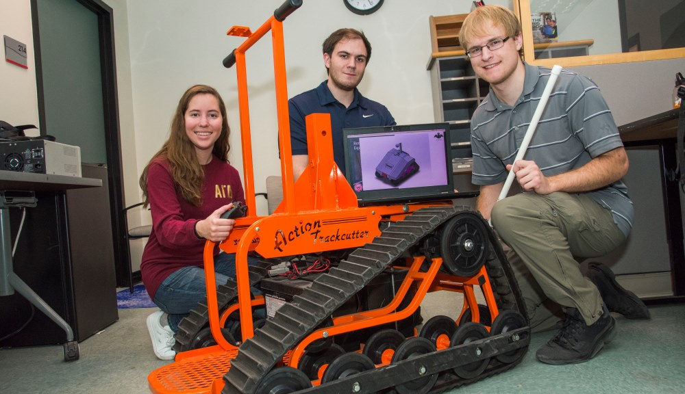 From left, seniors Marissa Bennett, Ken Quartuccio, and Jeff Tolbert with the Action Trackchair they are using as the base for their security robot