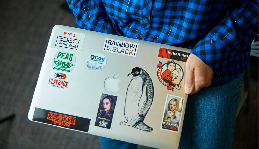Picture of Karen Casella's laptop with stickers of Netflix shows