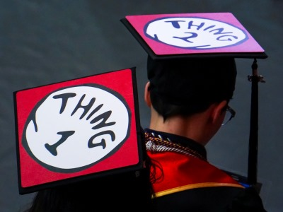 photo of graduates wearing caps that say Thing 1 and Thing 2