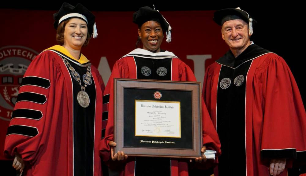Margot Lee Shetterly, center, author of the bestselling book Hidden Figures and speaker for Worcester Polytechnic Institute's 2018 Undergraduate Commencement, with WPI President Laurie Leshin and Jack T. Mollen, chair of the WPI Board of Trustees. Shetter
