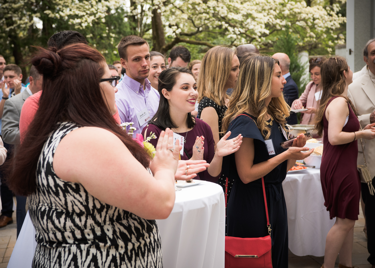 Students clapping at Senior Class Gift reception