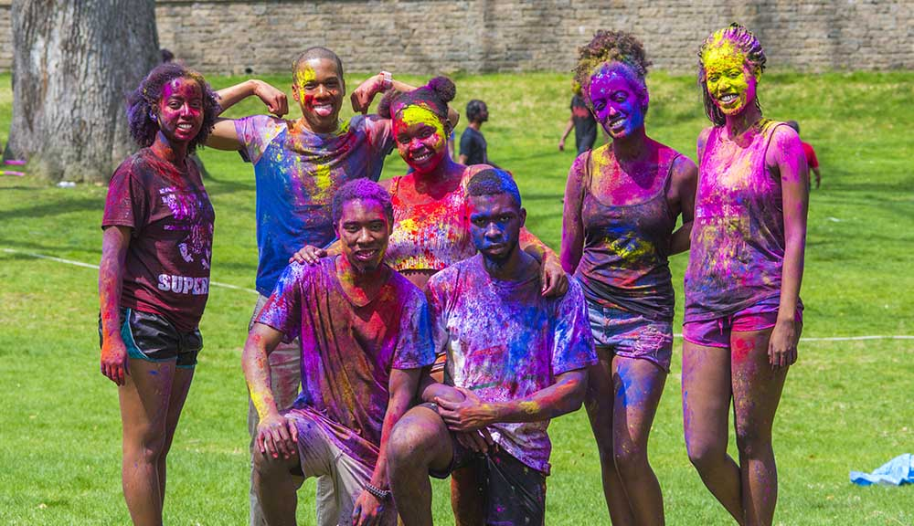 Covered in colors, students celebrate the festival of color, Holi, on the Higgins House lawn with the South Asian Student Association.