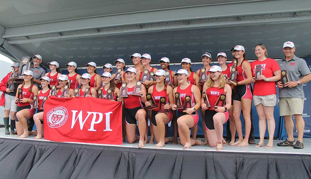 WPI's women's rowing team gathers on stage after placing third at the NCAA Division III Championships in Florida.