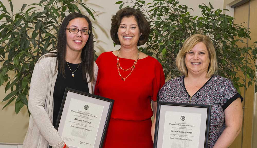Laurie Leshin stands with Allison Darling and Sue Sontgerath, who are both holding their awards and smiling.