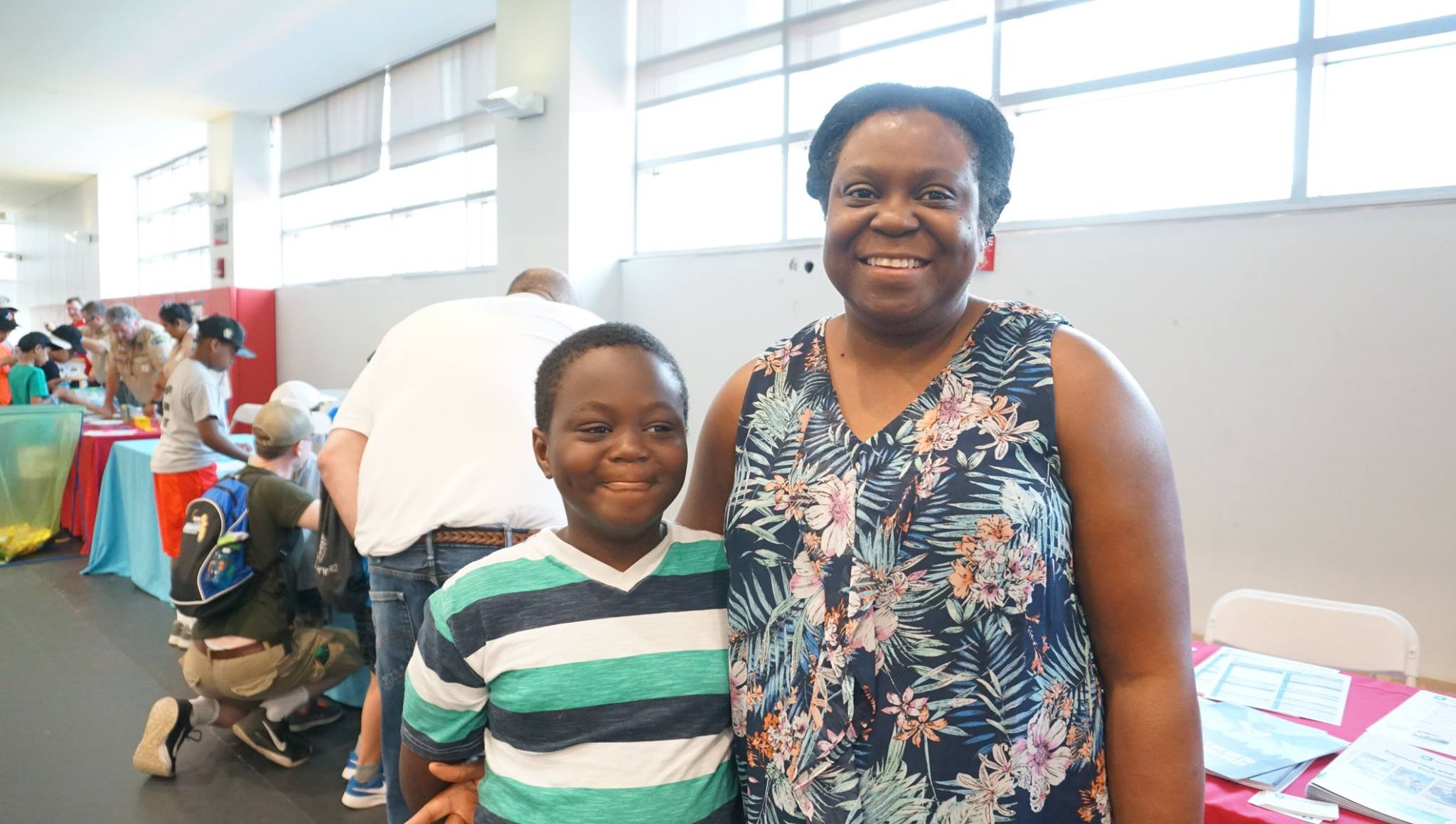 A son and mother smile together in the Sports & Rec Center.