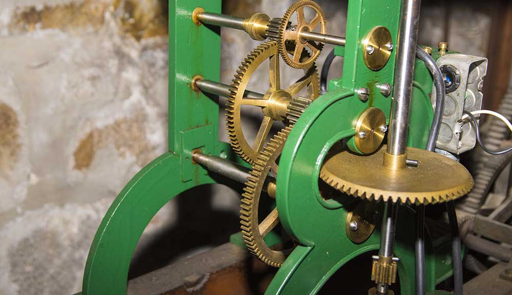 A close-up shot of gears inside the Boynton Hall clock tower.