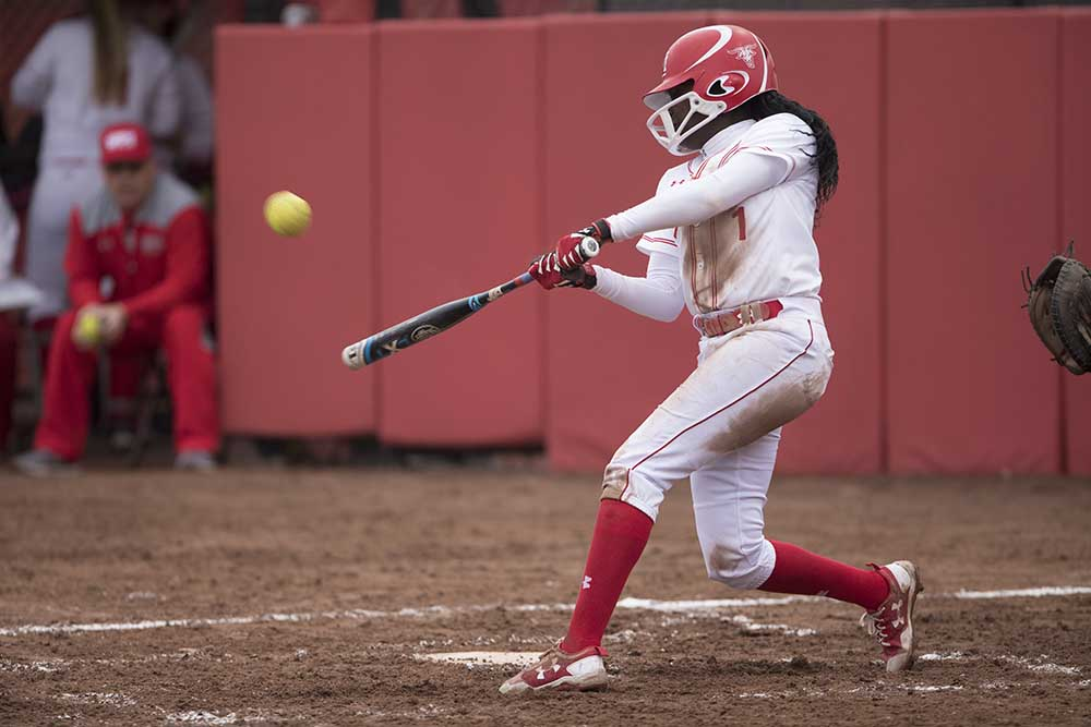 Ama Biney connects during a softball game for another home run.