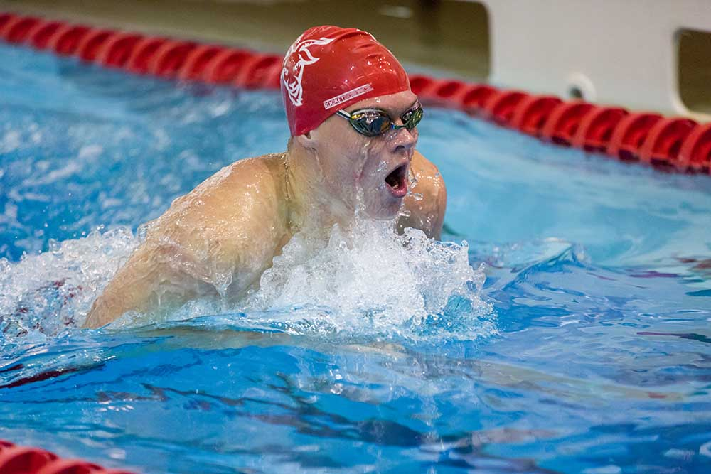 Jack Bauer engages in a swimming competition in the WPI pool at the Sports & Recreation Center.
