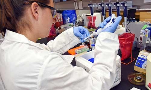Women WPI member working in a lab