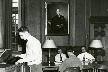 group of men sitting in alden memorial library