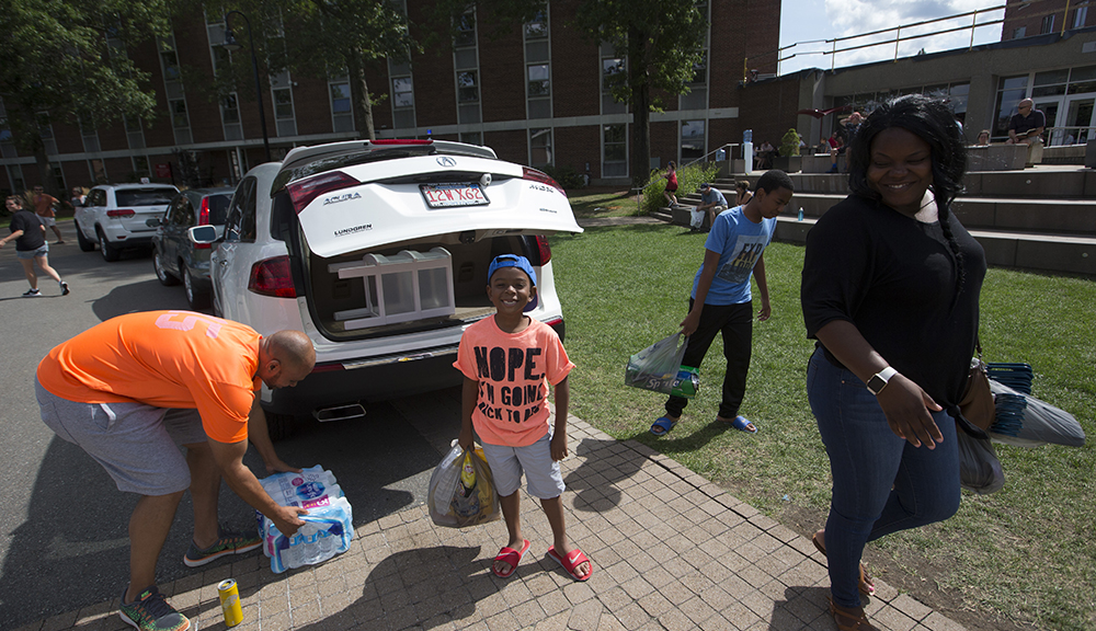 Family members help students move in during move-in day on the first day of New Student Orientation.