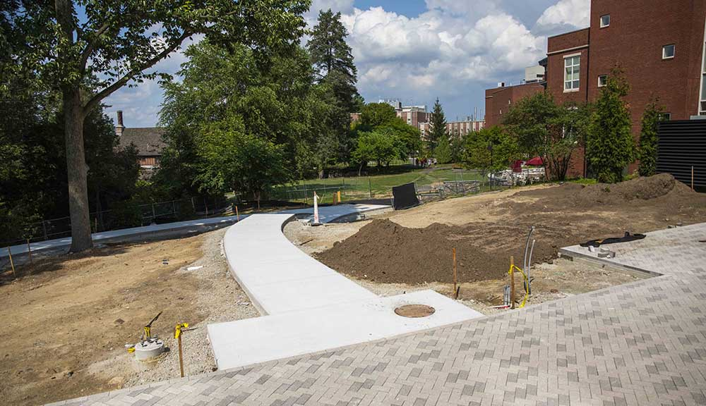 An in-progress photo of the rear walkway behind the Rubin Campus Center.