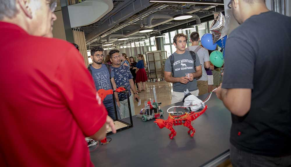 Students showcase their work, 3D-printed robotic cats, during the Foisie Innovation Studio grand opening.